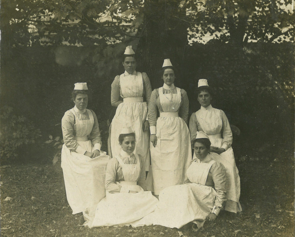 A group of six nurses in uniform, late 19th century