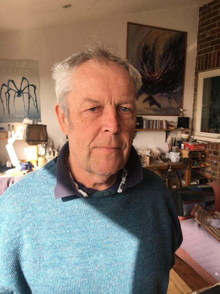 Photo of Chris Heape in a blue jumper.