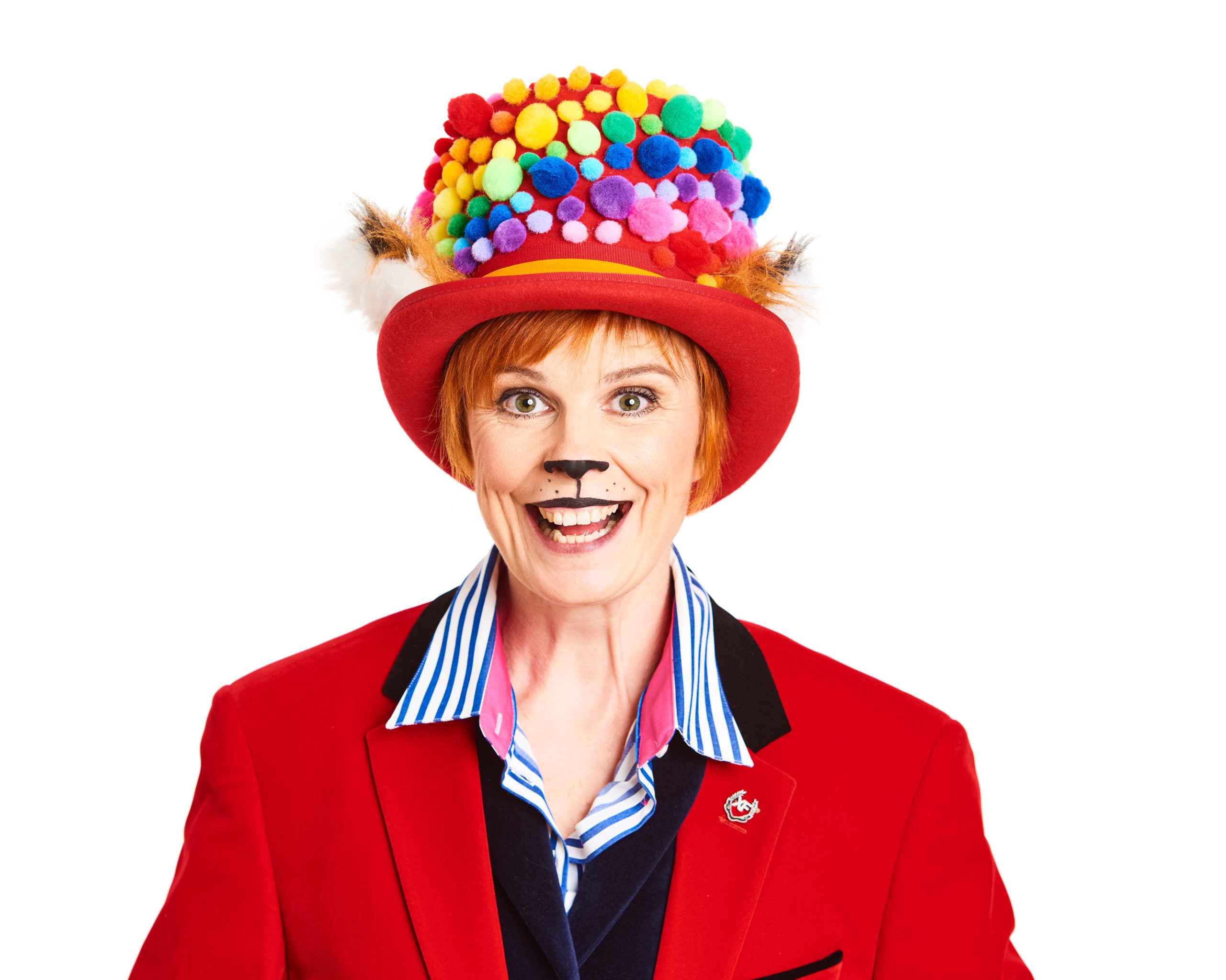 Photo of Louise Wells wearing a bright red jacket and top hat, which has a rainbow of 3D dots swirling around it.
